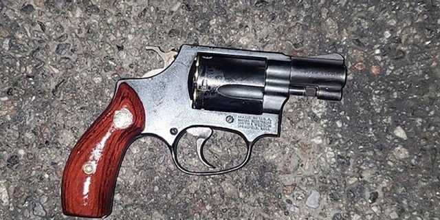 In this photo provided by the New York Police Department, a weapon lies on the pavement that police say was used in the attempted carjacking of an off-duty NYPD officer early on Nov. 11 in the Brooklyn. The city is grappling with a surge in violent crime and more brazen criminals following the shoving of two people onto subway train tracks in separate incidents that occurred hours apart this week. (NYPD via AP)