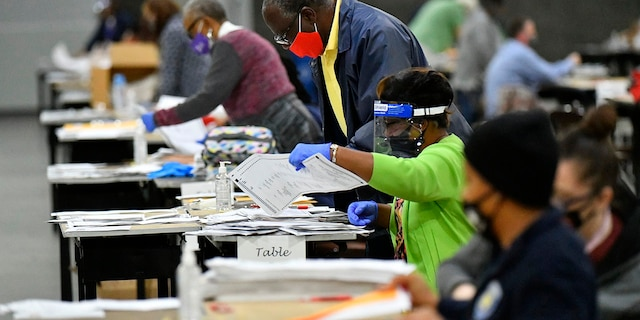 Election workers in Fulton County began working through a recount of ballots Saturday, Nov. 14, 2020 in Atlanta. (Associated Press)