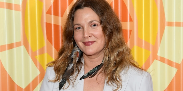 Drew Barrymore is part of the legendary Barrymore family, which included her estranged father, John. She was emancipatedfrom her parents by the age of 14. (Dimitrios Kambouris/Getty Images for The Charlize Theron Africa Outreach Project)