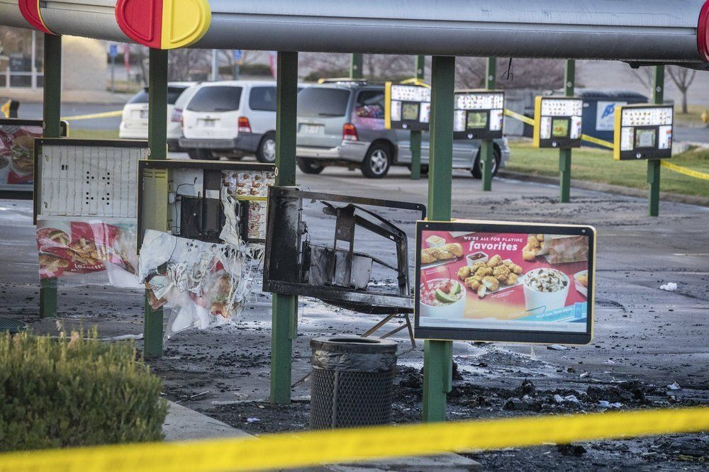 Video obtained by news outlets showed a vehicle on fire in the restaurant's parking lot where four people were shot.