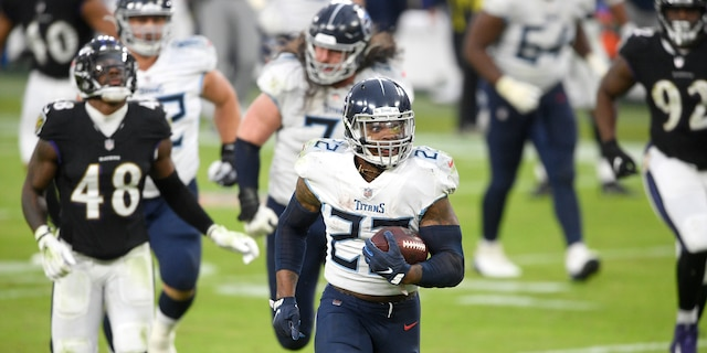 Tennessee Titans running back Derrick Henry (22) runs for a game-winning touchdown against the Baltimore Ravens during overtime of an NFL football game, Sunday, Nov. 22, 2020, in Baltimore. The Titans won 30-24 in overtime. (AP Photo/Nick Wass)