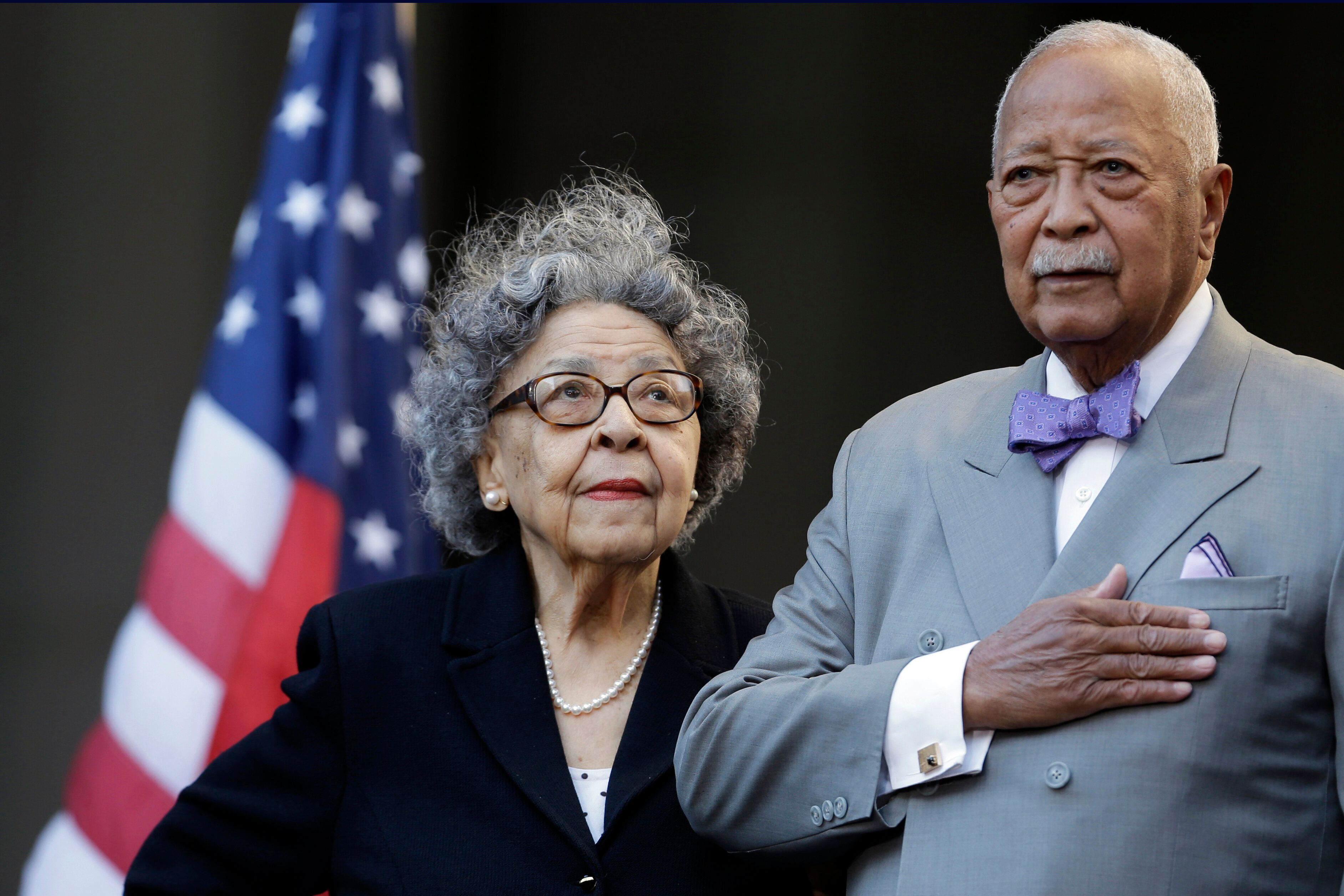 Former New York City Mayor David Dinkins, right, and his wife, Joyce Dinkins, participate in a ceremony renaming the Manhatta