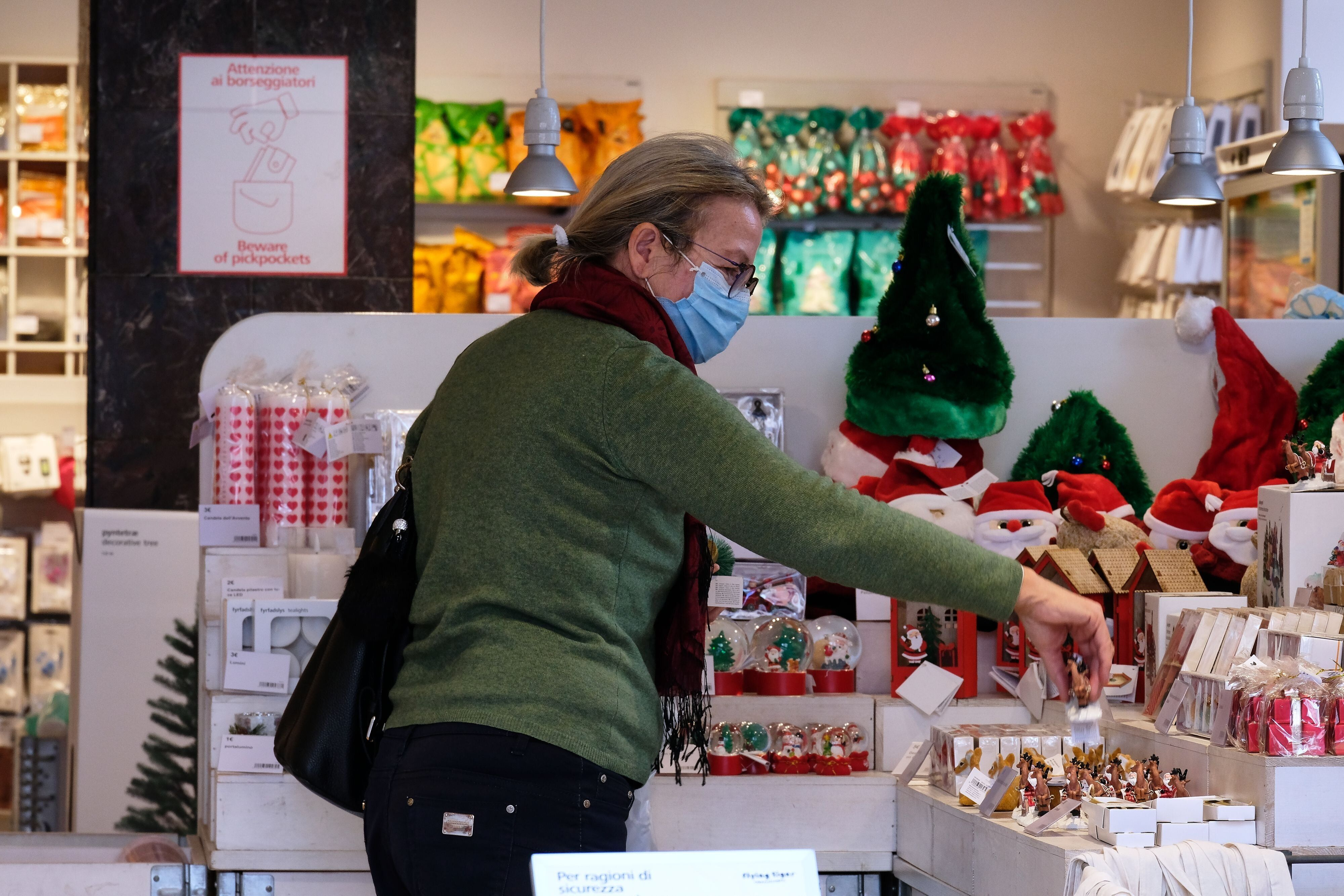 A shopper looks for a gift in central Rome in early November. Italian Prime Minister Giuseppe Contehas said that he wan