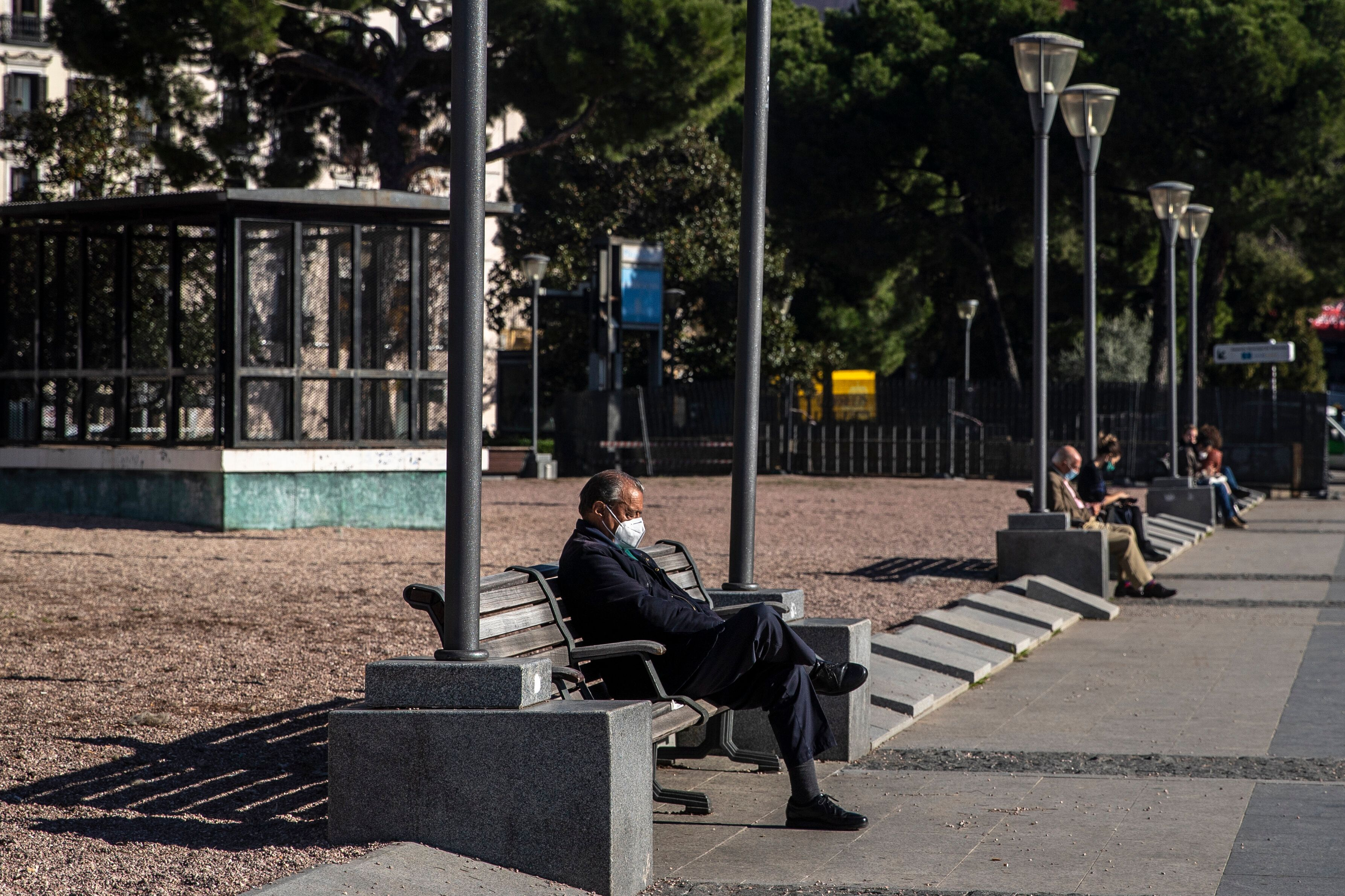 People wearing face masks in downtown Madrid on Monday. The Spanish government revealed Tuesday morning that family and socia