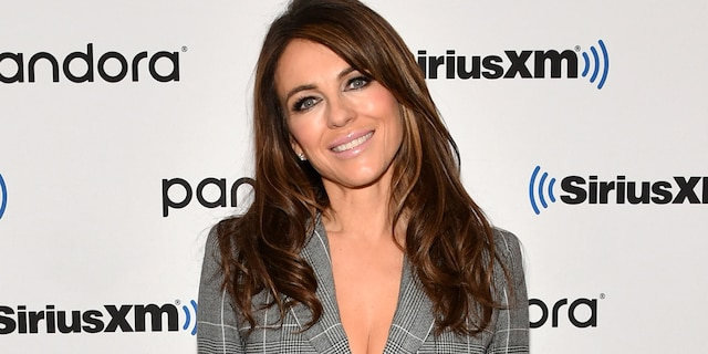 Elizabeth Hurley reflected on 'happy times' with a throwback bikini photo of herself on a beach.