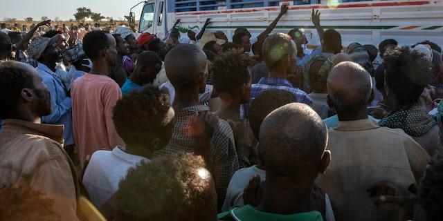 Tigray refugees who fled the conflict in Ethiopia's Tigray region, wait to receive aid at Umm Rakouba refugee camp in Qadarif, eastern Sudan, Tuesday, Nov. 24, 2020. (AP Photo/Nariman El-Mofty)