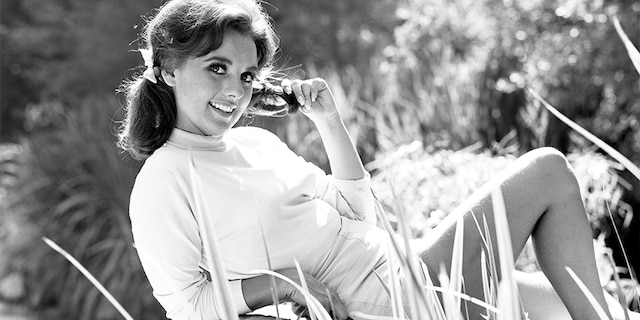 "Dawn Wells portrays Mary Ann Summers in the CBS television program ""Gilligan's Island."""