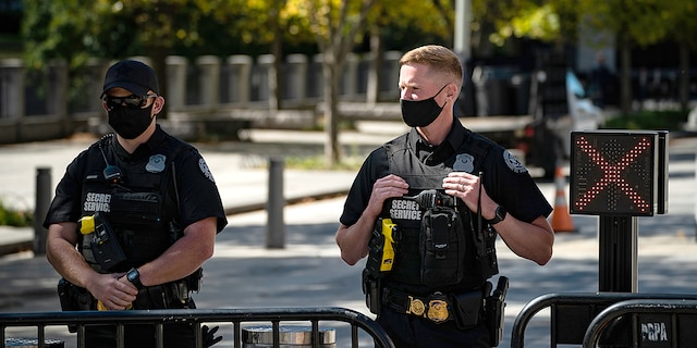 Members of the Secret Service wearing face masks stand outside the White House in Washington, D.C. on Thursday, October 8, 2020. (Getty Images)