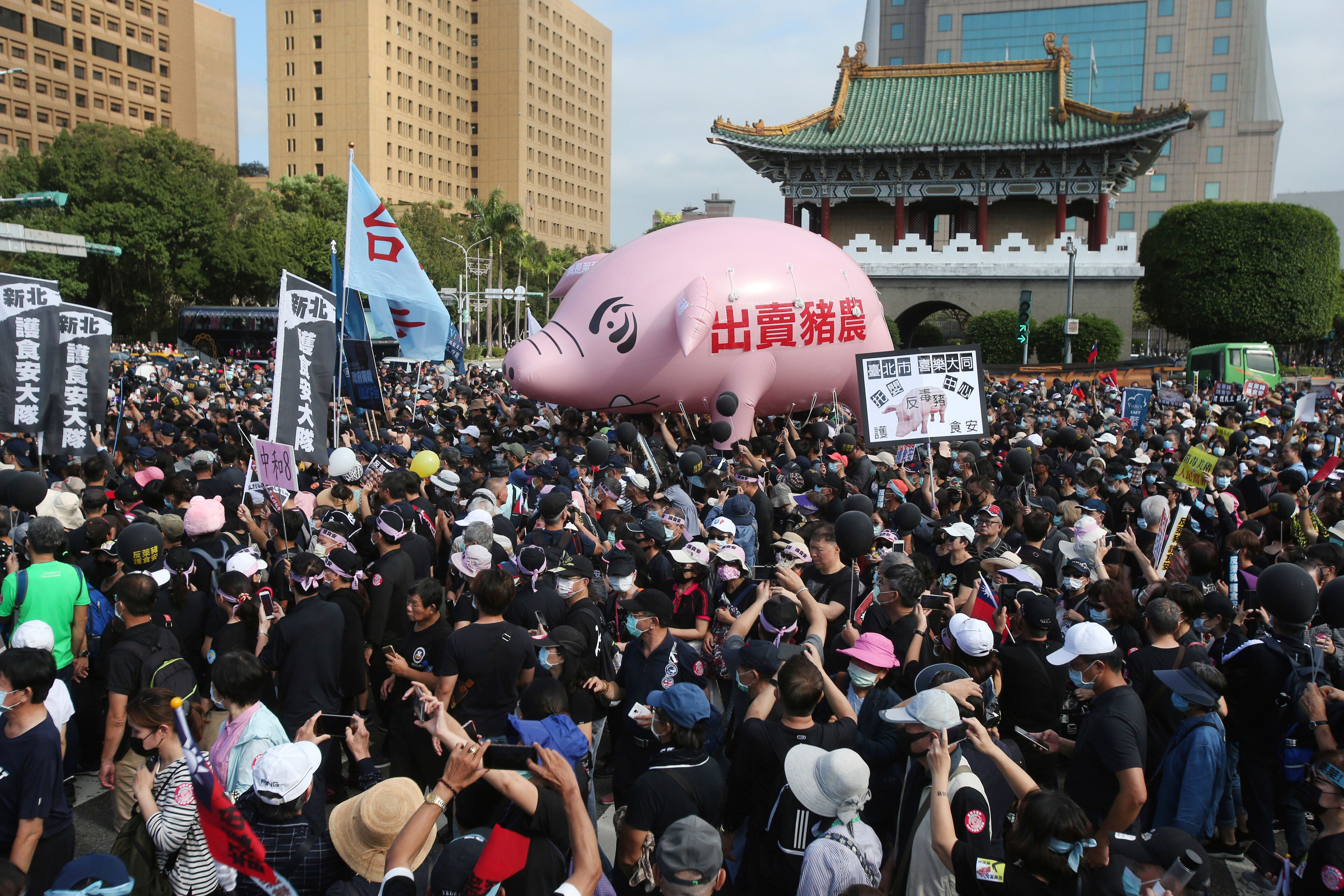 Thousands of people marched in streets on Sunday demanding the reversal of a decision to allow U.S. pork imports into Taiwan,