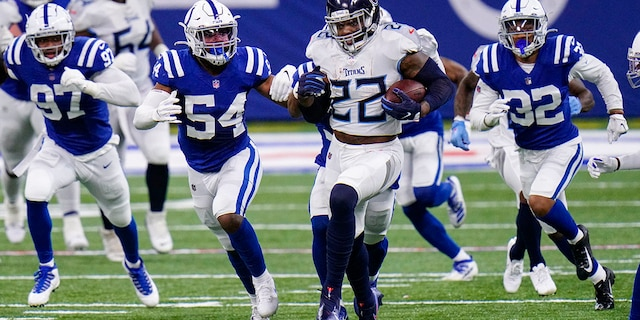 Tennessee Titans running back Derrick Henry (22) runs against the Tennessee Titans in the first half of an NFL football game in Indianapolis, Sunday, Nov. 29, 2020. (AP Photo/AJ Mast)