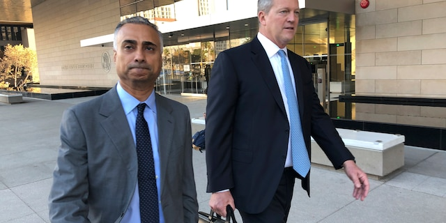 "FILE - In this Nov. 22, 2019 file photo, Imaad Zuberi, left, leaves the federal courthouse in Los Angeles with his attorney Thomas O'Brien, right, after pleading guilty to funneling donations from foreigners to U.S. political campaigns. Zuberi, an elite political fundraiser, had the ear of top Democrats and Republicans alike — a reach that included private meetings with then-Vice President Joe Biden and VIP access at Donald Trump's inauguration. But federal prosecutors say Zuberi's life was built on a series of lies and the lucrative enterprise of filling the campaign coffers of American politicians and profiting from the resulting influence. They describe him as a ""mercenary"" political donor who gave to anyone -- often using foreign money given through illegal straw donors. (AP Photo/Brian Melley, File)"