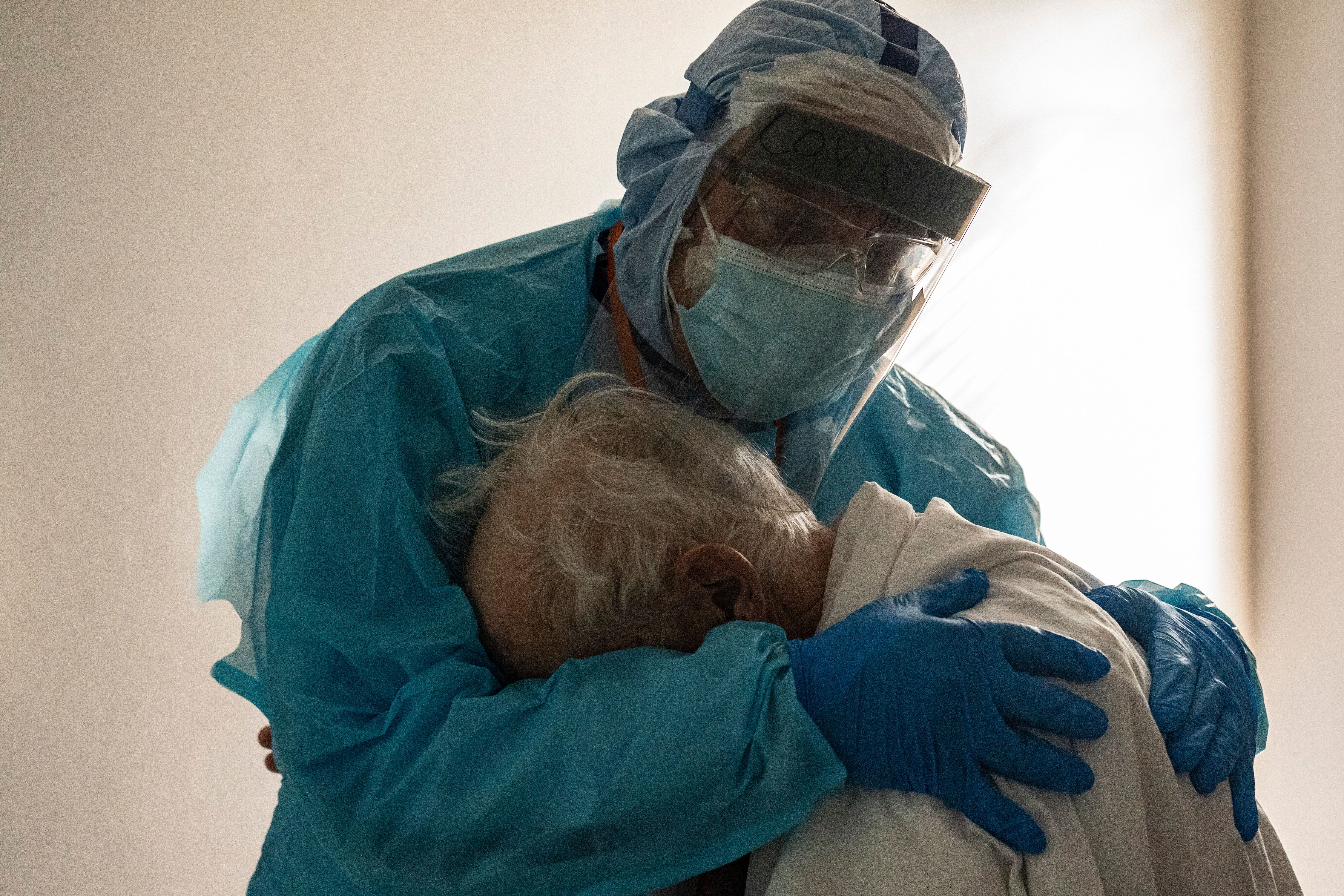 Dr. Joseph Varon hugs and comforts a patient in the COVID-19 intensive care unit on Thanksgiving day at the United Memorial M