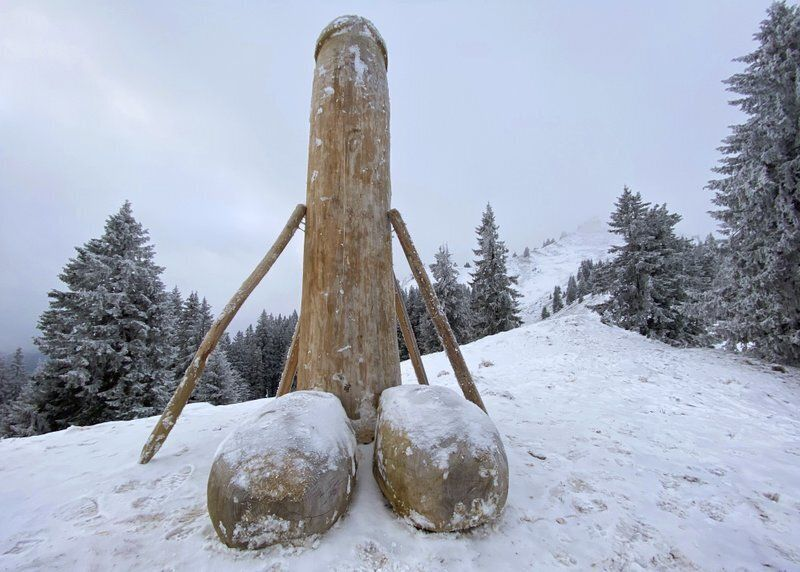A wooden phallus sculpture about two meters high stands on the Gruenten mountain, Rettneberg, Germany, Thursday, Dec. 3, 2020