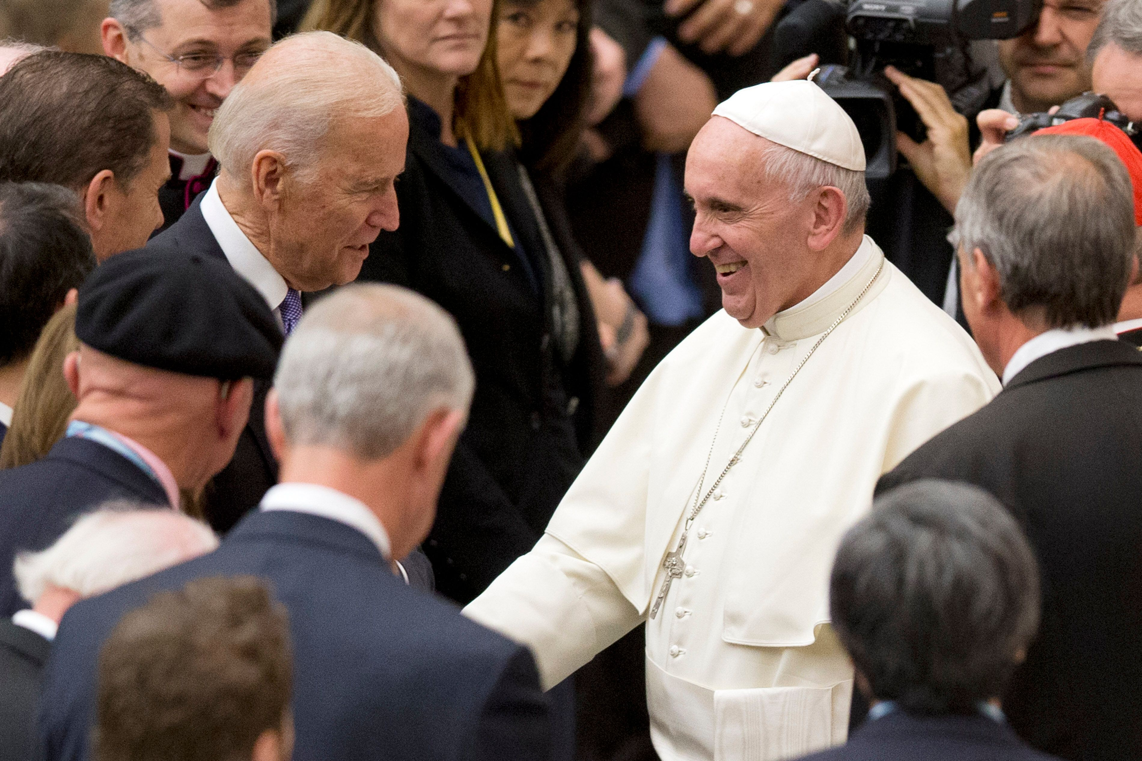 Then-Vice President Joe Biden shakes hands with Pope Francis during a conference in April 2016 on cancer research at the