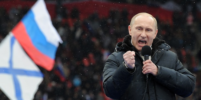 Russian Presidential candidate, Prime Minister Vladimir Putin delivers a speech during a rally of his supporters at the Luzhniki stadium in Moscow on Feb. 23, 2012. (Photo credit should read YURI KADOBNOV/AFP via Getty Images)