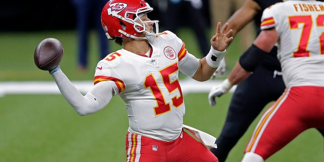 Kansas City Chiefs quarterback Patrick Mahomes (15) passes in the first half of an NFL football game against the New Orleans Saints in New Orleans, Sunday, Dec. 20, 2020. (AP Photo/Brett Duke)