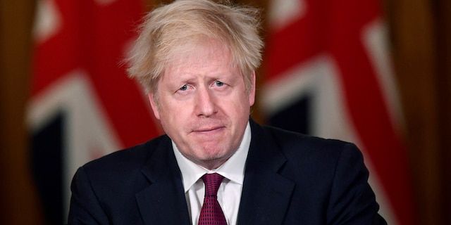 Britain's Prime Minister Boris Johnson speaks during a news conference in response to the ongoing situation with the coronavirus (COVID-19) pandemic, inside 10 Downing Street, London, Saturday, Dec. 19, 2020. Johnson says Christmas gatherings can't go ahead and nonessential shops must close in London and much of southern England as he imposed a new, higher level of coronavirus restrictions to curb rapidly spreading infections. (Toby Melville/Pool Photo via AP)
