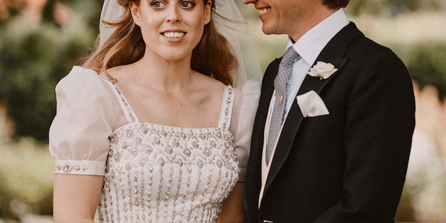 In this photograph released on Sunday, July 19, 2020, by the Royal Communications of Princess Beatrice and Edoardo Mapelli Mozzi, showing Britain's Princess Beatrice and Edoardo Mapelli Mozzi as they pose for a photo on Friday July 17, 2020, after their wedding at The Royal Chapel of All Saints at Royal Lodge, Windsor, England. (Benjamin Wheeler/Royal Communications of Princess Beatrice and Edoardo Mapelli Mozzi via AP)