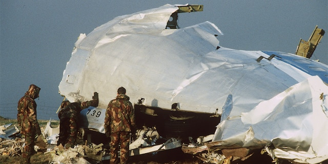 Crash investigators search the area around the cockpit of Pan Am flight 103 in a farmer's field east of Lockerbie Scotland after a mid-air bombing killed all 259 passengers and crew, and 11 people on the ground.