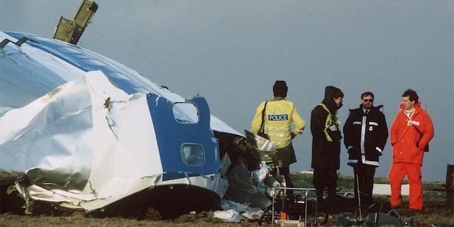 Scottish rescue workers and crash investigators search the area around the cockpit of Pan Am flight 103 in a farmer's field east of Lockerbie Scotland after a mid-air bombing killed all 259 passengers and crew, and 11 people on the ground.