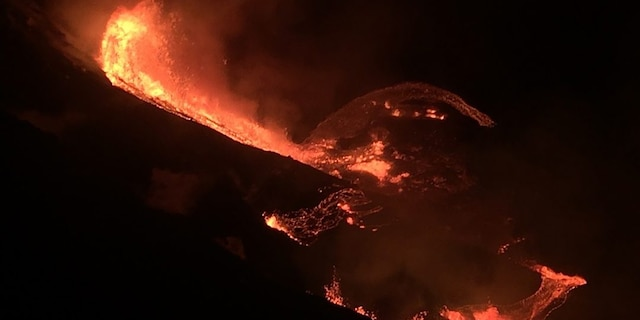 In this photo provided by the U.S. Geological Survey, lava flows within the Halema'uma'u crater of the Kilauea volcano Sunday, Dec. 20, 2020. The Kilauea volcano on Hawaii's Big Island has erupted, the U.S. Geological Survey said. (U.S. Geological Survey via AP)
