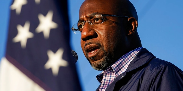 In this Nov. 15 photo, Raphael Warnock, a Democratic candidate for the U.S. Senate, speaks during a campaign rally in Marietta, Ga. (AP Photo/Brynn Anderson, File)