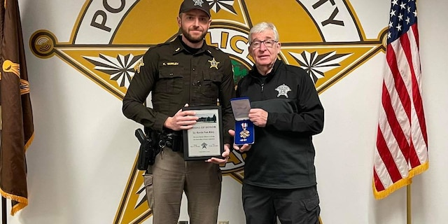 Porter County Sheriff David Reynolds honors Lt. Kevin Van Kley with the department's Medal of Honor. (Porter County Sheriff's Office)