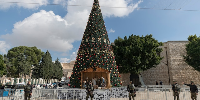 A Palestinian National security unit is deployed in Manger Square, adjacent to the Church of the Nativity, traditionally believed by Christians to be the birthplace of Jesus Christ, ahead of Christmas, in the West Bank city of Bethlehem, Wednesday, Dec. 23, 2020. (AP Photo/Nasser Nasser)