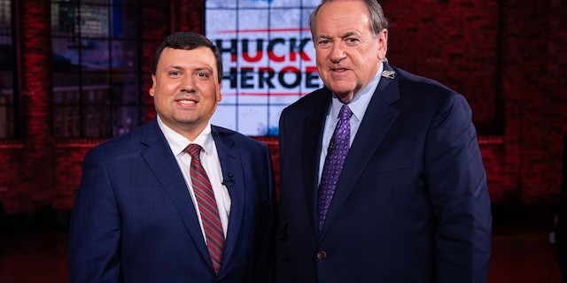 """Xavier DeGroat, a Michigan student, with former Gov. Mike Huckabee. DeGroat was honored as a """"hero"""" on Huckabee's show in 2020."""