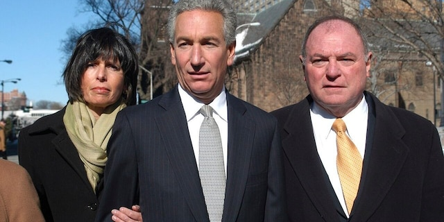 In this March 4, 2005 file photo, Charles B. Kushner, flanked by his wife, Seryl Beth, left, and his attorney Alfred DeCotiis arrives at the Newark Federal Court for sentencing in Newark, N.J. (AP Photo/Marko Georgiev)