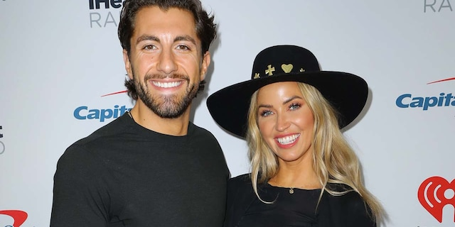 Jason Tartick (left) and Kaitlyn Bristowe (right) say they have contracted coronavirus after having a visitor in their home. (Photo by JC Olivera/Getty Images)