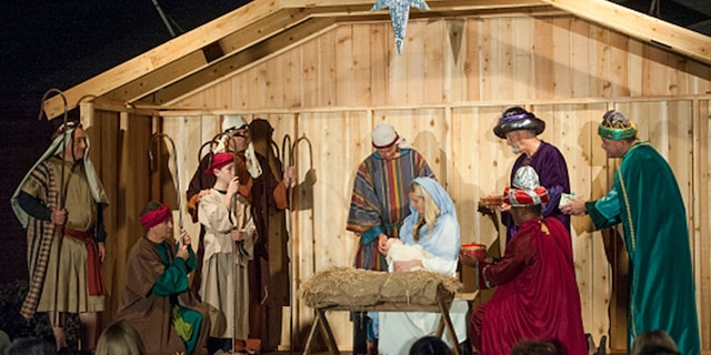 FOUNTAIN VALLEY, CA - DECEMBER 10: Volunteers portray the manger scene outside the Church of Jesus Christ in Fountain Valley as part of the church's living creche this year. (Photo by Kevin Sullivan/Digital First Media/Orange County Register via Getty Images)