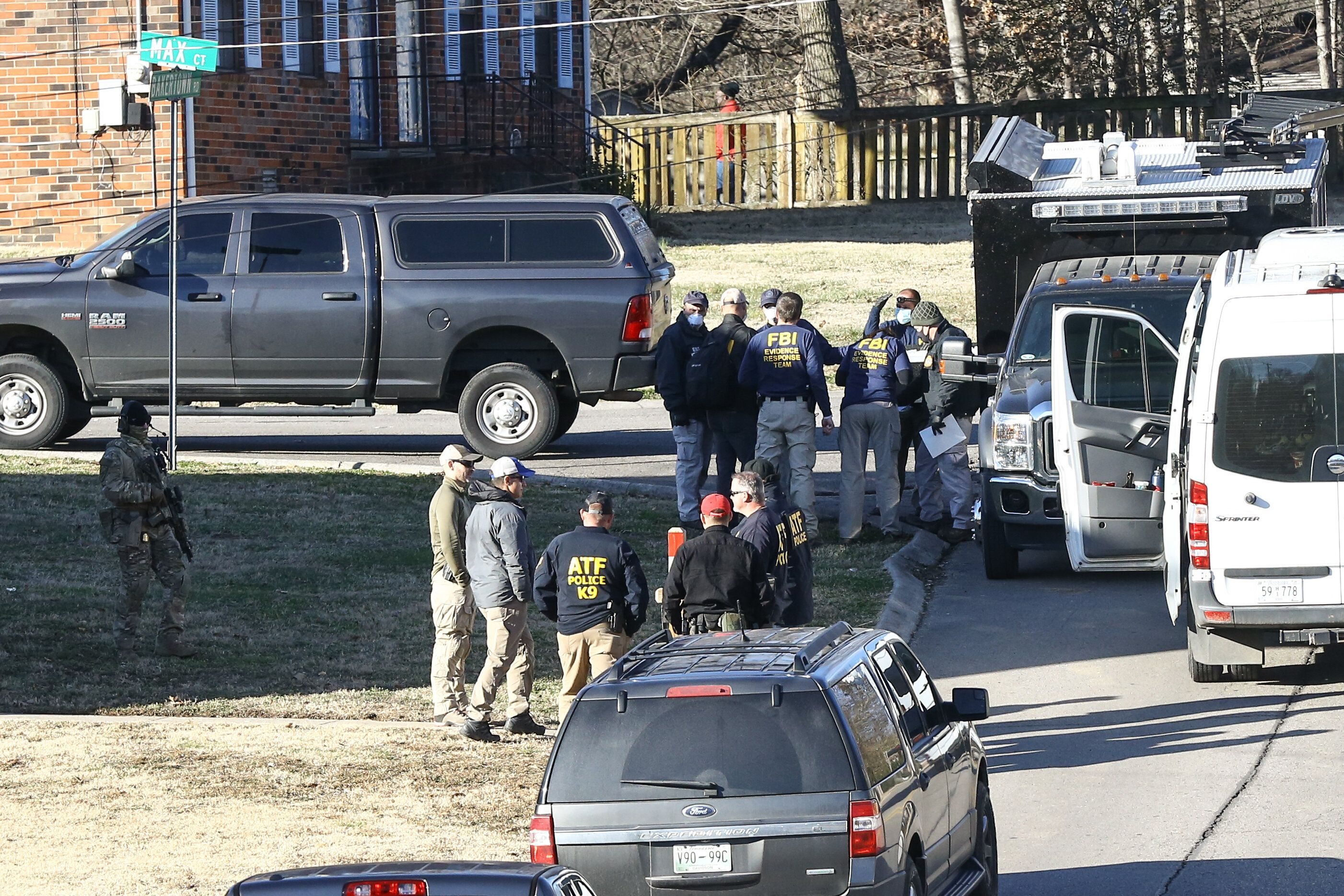 Law enforcement officers investigate the house belonging to Anthony Quinn Warner, a 63 year-old man who has been reported to
