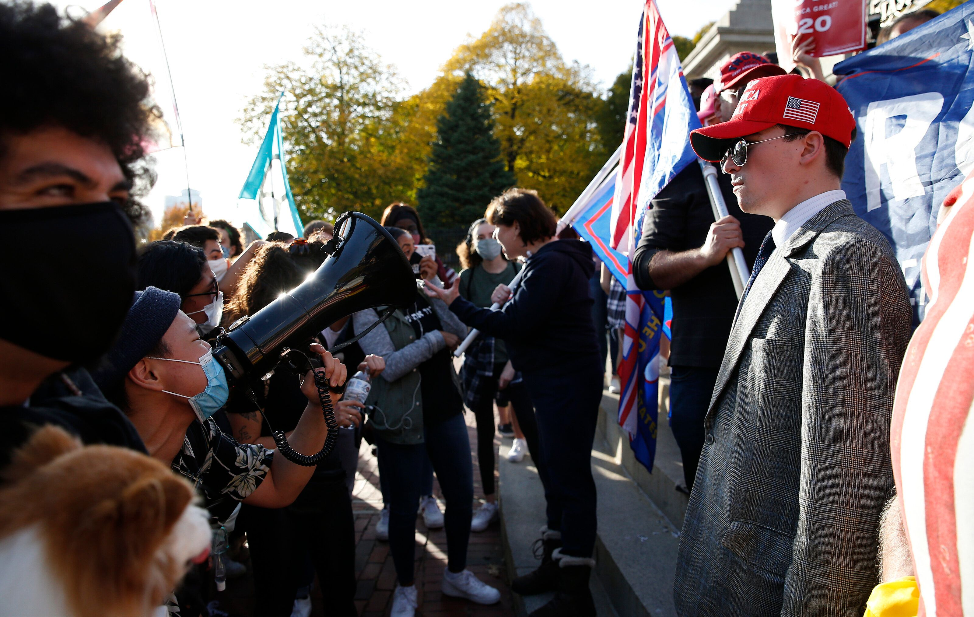 Biden supporters and Trump supporters faced off at the State House in a mostly peaceful confrontation in Boston on Nov. 7, 20