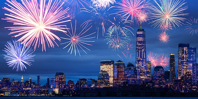 Night time fireworks celebration over Hudson harbor to New York panorama view
