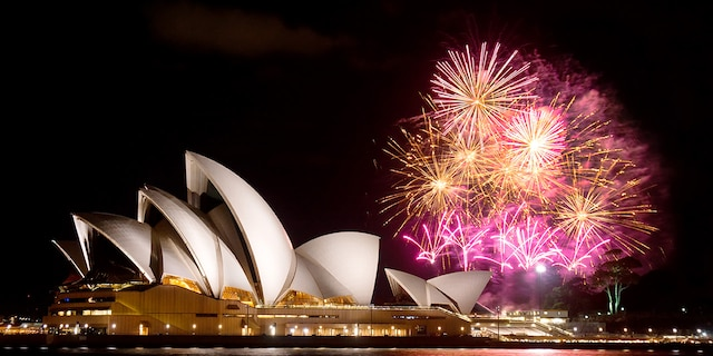 Sydney, Australia - April 9, 2014: Fireworks erupt behind the Sydney Opera House at night, as part of a Madama Butterfly opera being staged on Sydney Harbour.