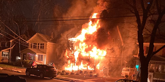 The Mojica's home in Metuchen, N.J. engulfed in flames.