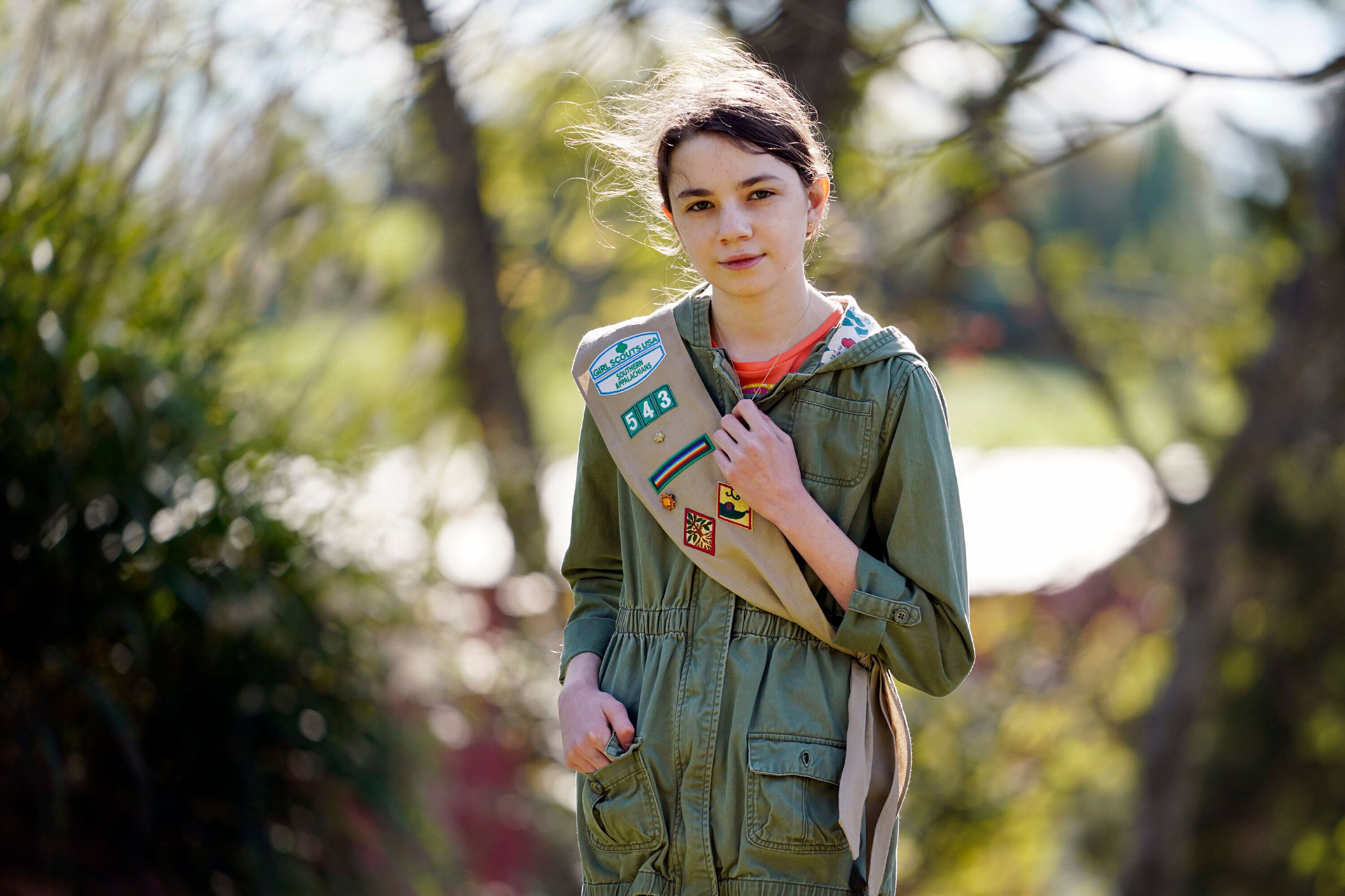 Olivia Chaffin, 14, stands for a portrait with her Girl Scout sash in Jonesborough, Tenn., on Nov. 1. Olivia is asking Girl S