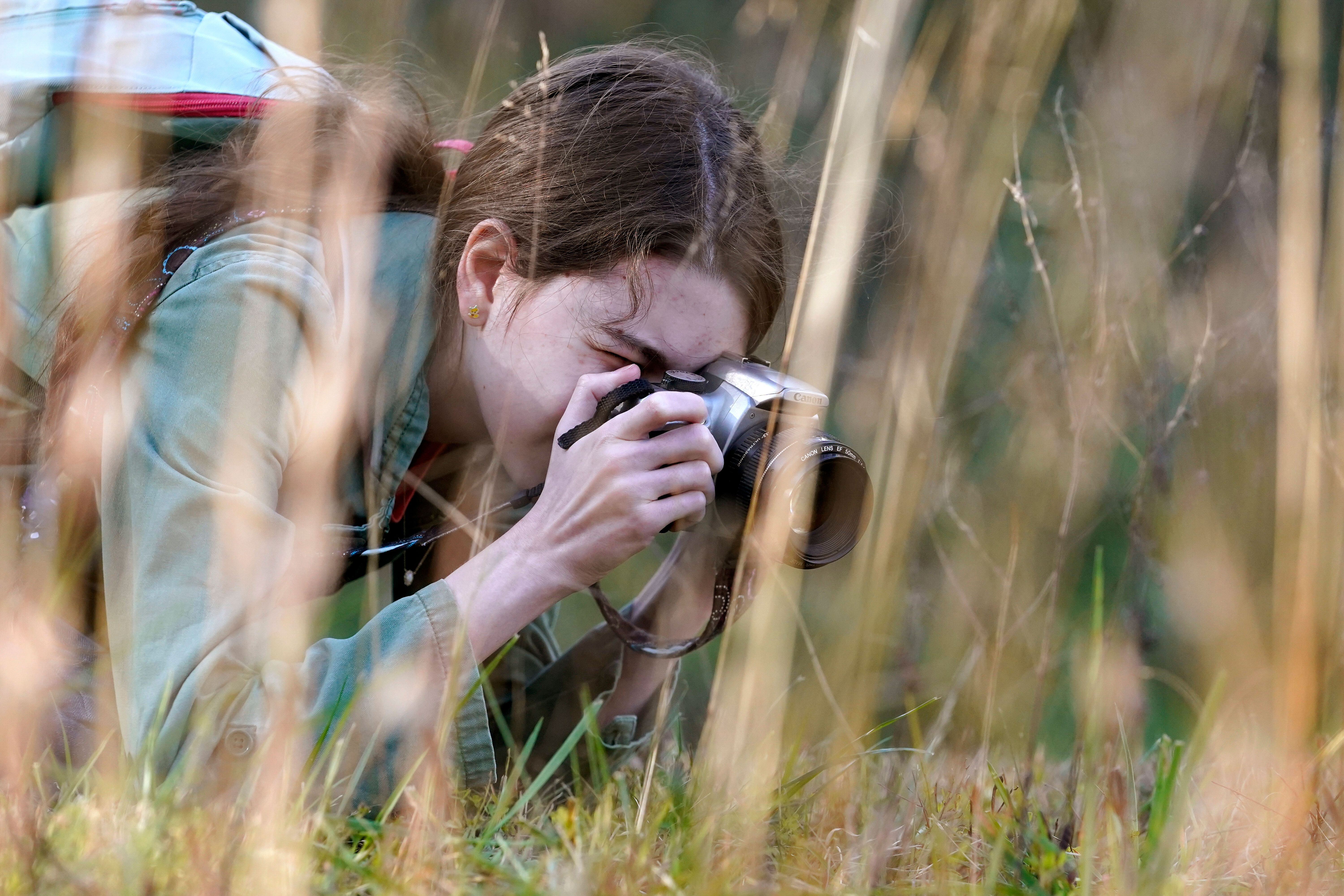 Olivia Chaffin takes photographs in a wooded area as she works on a Girl Scout photography merit badge in Jonesborough.