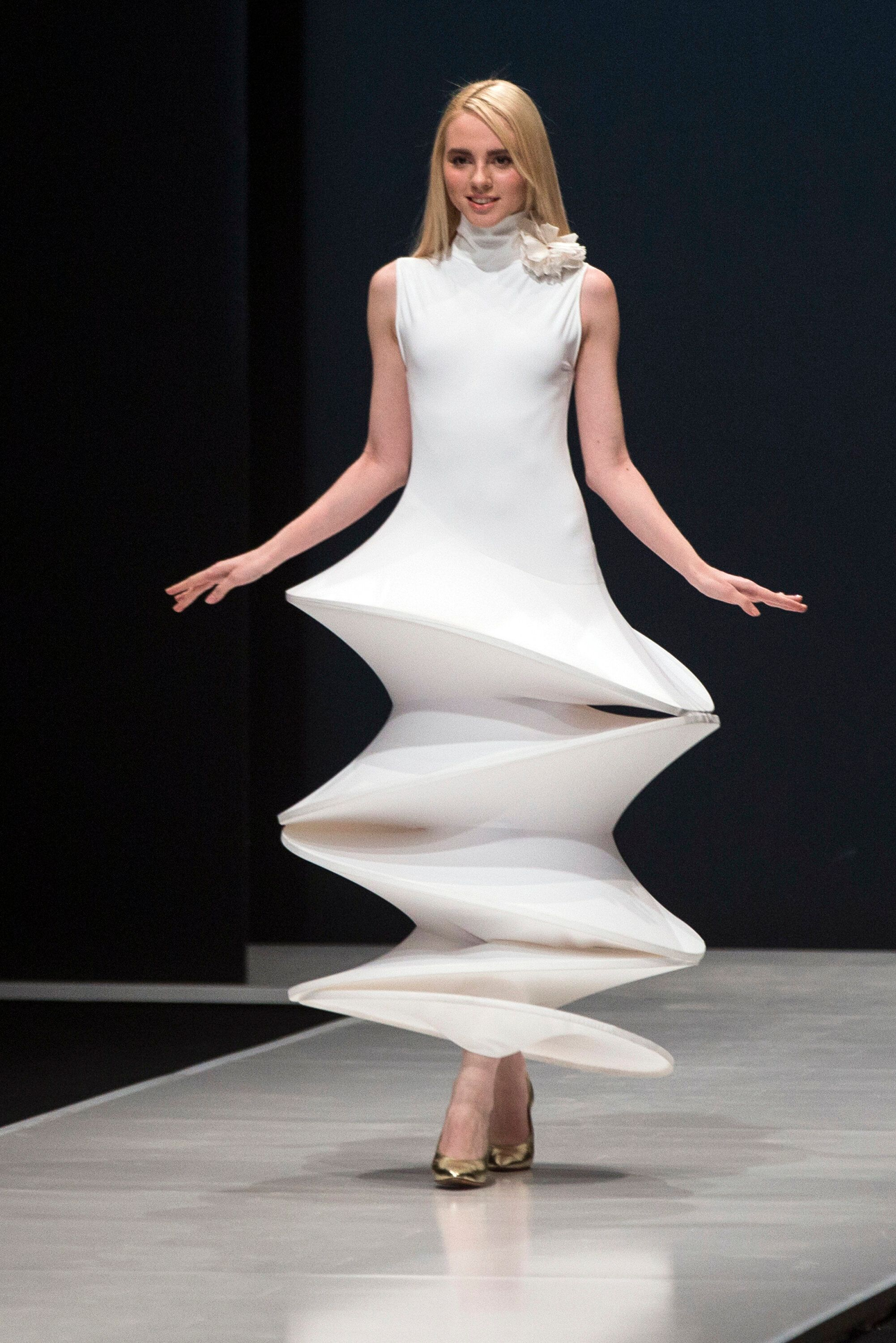 A model displays a creation by Pierre Cardin during Moscow Fashion Week in 2016.