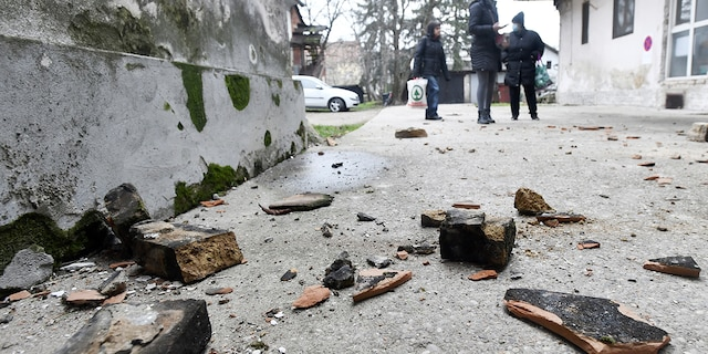 Residents inspect damage caused by an earthquake in Sisak, Croatia, Monday, Dec. 28, 2020. A moderate earthquake has hit central Croatia near its capital of Zagreb, triggering panic and some damage south of the city. There were no immediate reports of injuries. (AP Photo)