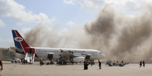 Dust rises after explosions hit Aden airport upon the arrival of the newly-formed Yemeni government, on Dec. 30. (Reuters)