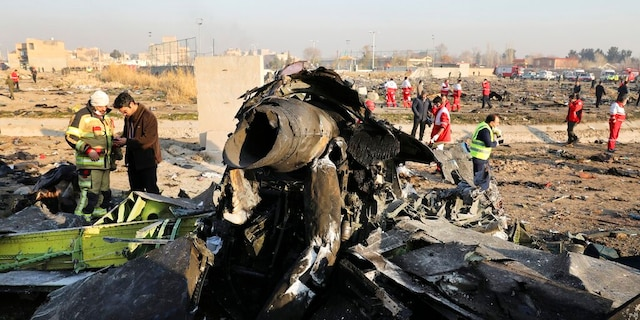 FILE: Debris litters the scene where a Ukrainian plane crashed in Shahedshahr southwest of the capital Tehran, Iran.