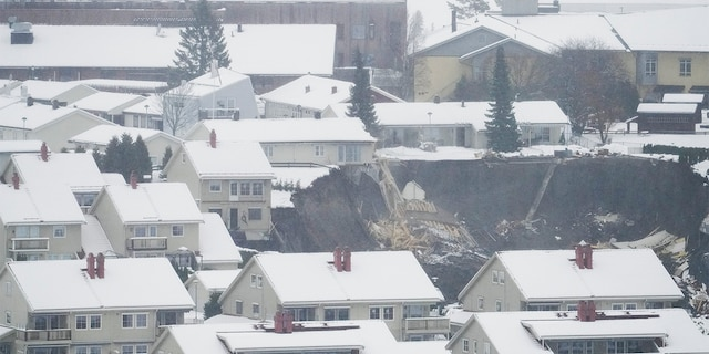 A massive landslide struck the small Norwegian town of Ask Wednesday morning around 4 a.m., leaving 10 people injured and nearly two dozen unaccounted for.(Fredrik Hagen/NTB via AP)