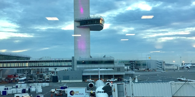 Pictured here is a window view of John F. Kennedy International Airport's control tower. On Dec. 28, 2020, a man fled the airport when a handgun was found in his carry-on bag. (Transportation Security Administration)