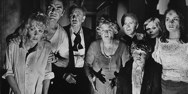 """Some of the cast of """"The Poseidon Adventure,"""" directed by Ronald Neame and Irwin Allen, 1972. Left to right: Stella Stevens, Ernest Borgnine, Jack Albertson, Shelley Winters, Red Buttons, Eric Shea, Carol Lynley and Pamela Sue Martin."""