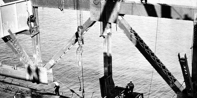 Workmen assist the derrick operator, chief engineer Joseph Strauss, in joining the center of the Golden Gate Bridge in San Francisco, Ca., Nov. 18, 1936. The bridge has a main span of 4,200 feet, 1,280 meters, making it the world's longest suspension structure. (AP Photo)