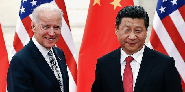 Chinese President Xi Jinping shakes hands with Vice President Joe Biden inside the Great Hall of the People in Beijing Dec. 4, 2013. (REUTERS/Lintao Zhang/Pool)