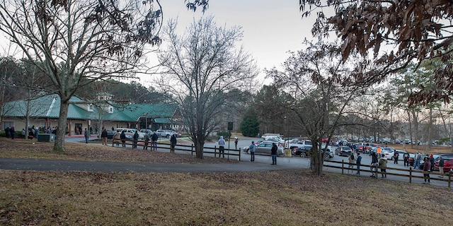 Voters wait in line to cast their ballots in Georgia's Senate runoff elections at a senior center, Tuesday, Jan. 5, 2021, in Acworth, Ga. (AP Photo/Branden Camp)