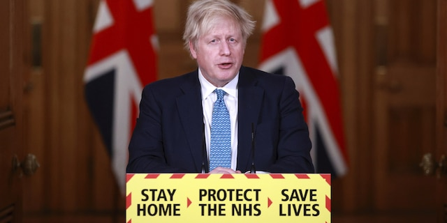 Britain's Prime Minister Boris Johnson speaks during a news conference inside 10 Downing Street in London on Tuesday. (AP)